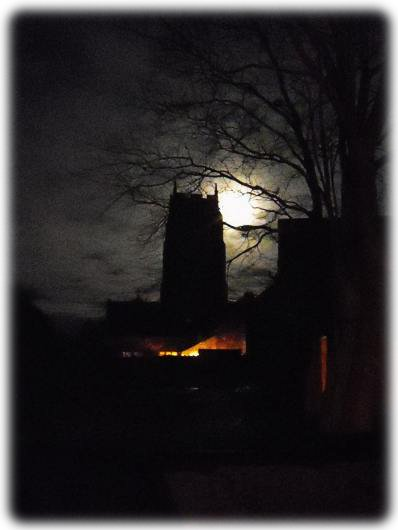 St. Mary's Tower,Holme-next-the-Sea. A moody view with the moon backlighting the tower - Photo &copy Tony Foster